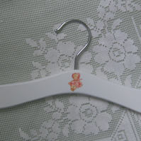 Baby hanger with vintage doll decoration