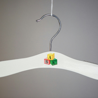 Baby hanger with ABC blocks