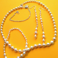 cream faux pearl necklace, earrings and bracelet set.