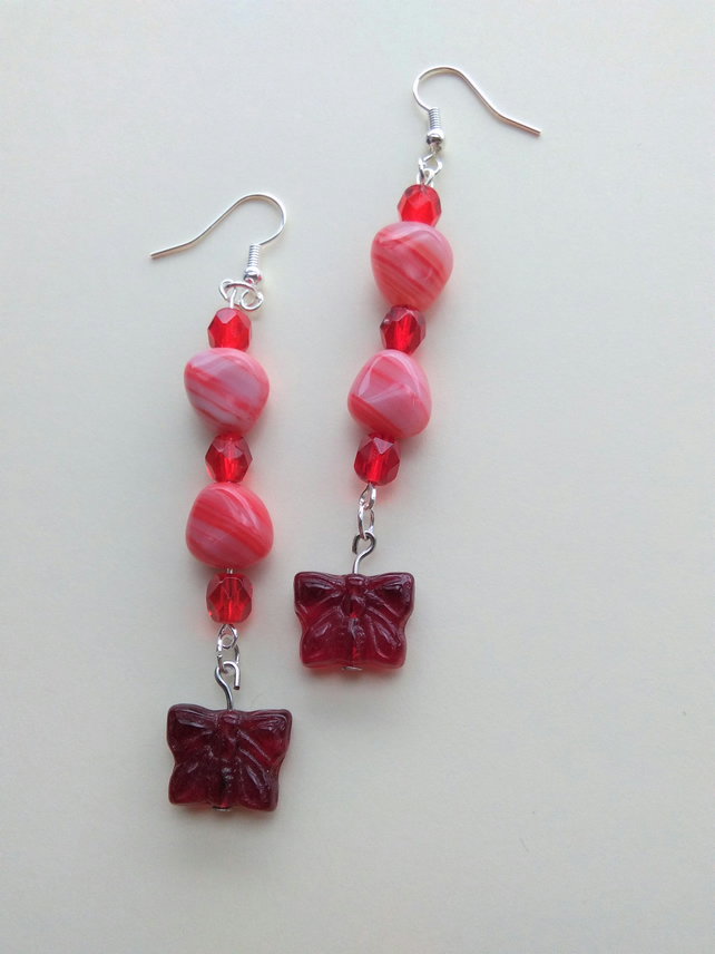 handmade earrings pink with red faceted beads and butterfly drop