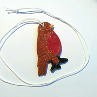 Brown and red clay bird pendant
