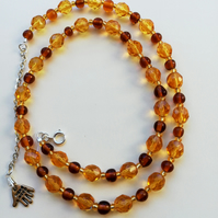 Topaz round and faceted bead necklace with gold seed beads