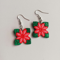 Red and pink flowers on forest green background earrings