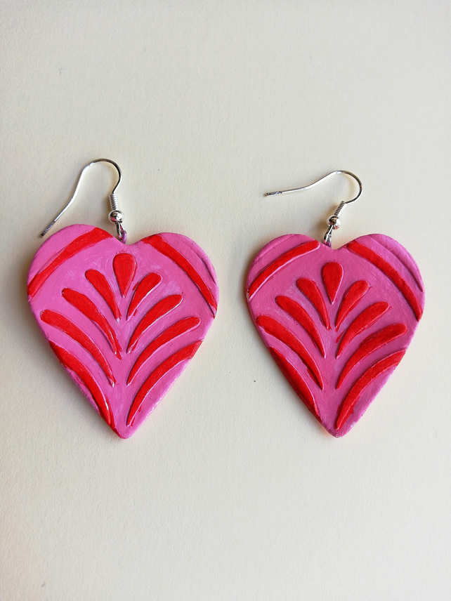 Pastel pink hearts with red fan pattern earrings