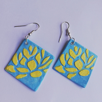 Yellow water lillies on blue background, earrings