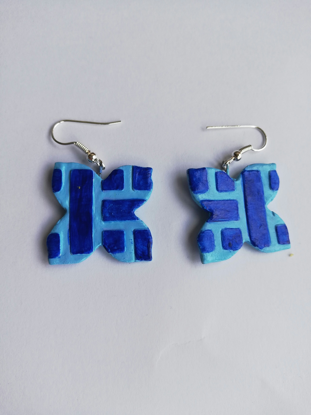 Blue earrings with embossed modern pattern.