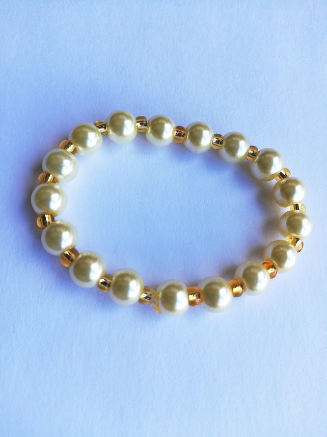 cream pearl and golden yellow bracelet