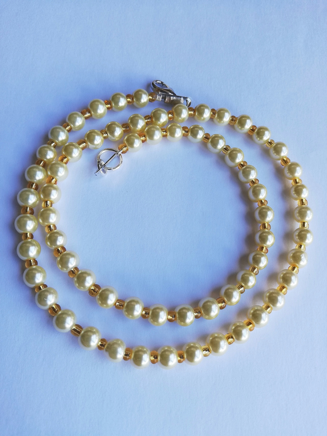 cream pearl and golden yellow necklace