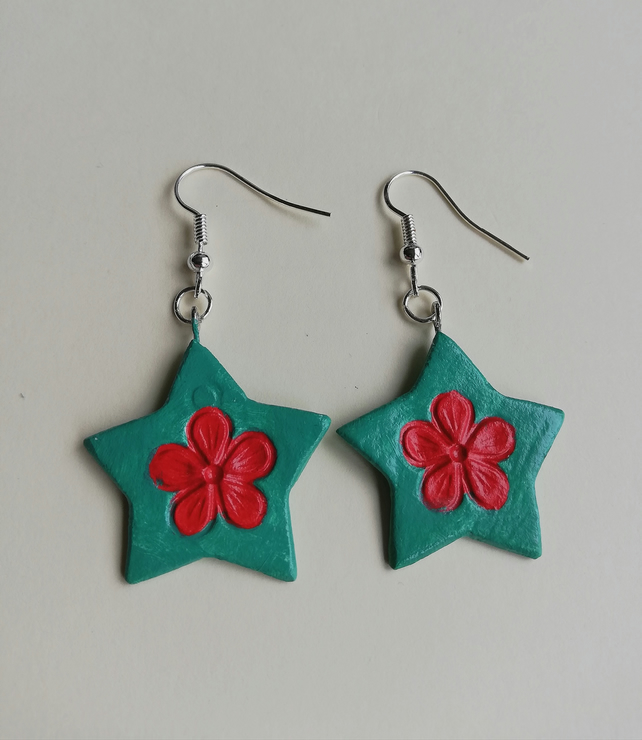 Bright red flowers on green star earrings