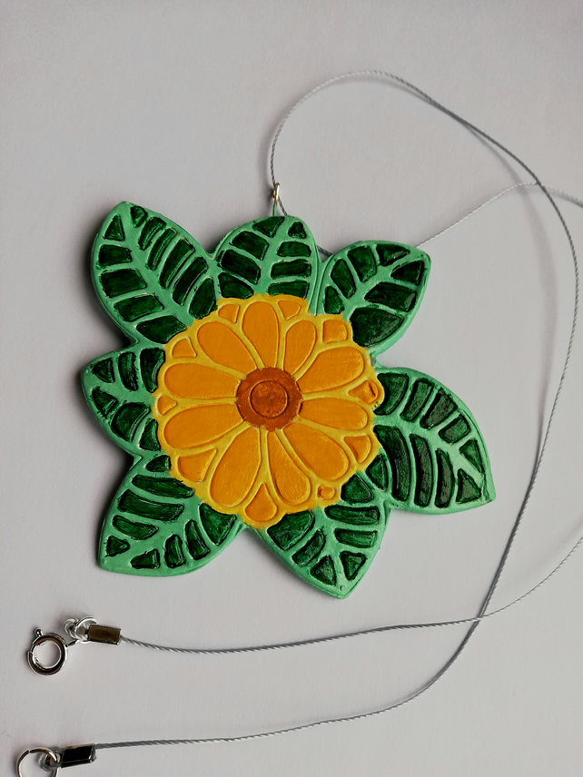 Orange-yellow flower with green foliage pendant
