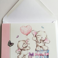 Elephant birthday card with gifts and heart shaped balloon