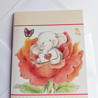 Blank card showing an elephant, flower and letter