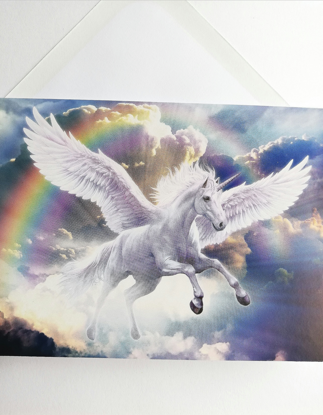 Blank card with flying unicorn and rainbow