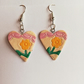 Heart earrings with banner and flower