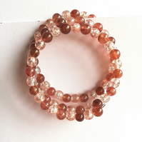 Semi-precious strawberry quartz and antique pink bead bracelet and earrings.
