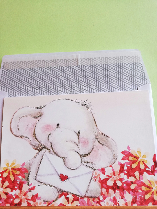 Horizontal fold special occassion card showing elephant with envelope