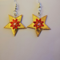 Gold stars with red Christmas flowers