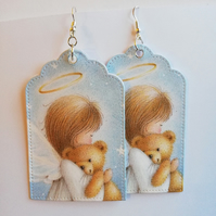 Christmas earrings, showing angel with teddy bear