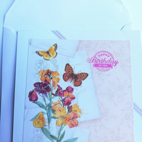 Birthday card showing butterflies and flowers
