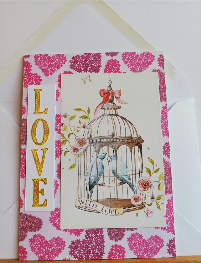 Birthday card showing bird cage, love birds and flowers.