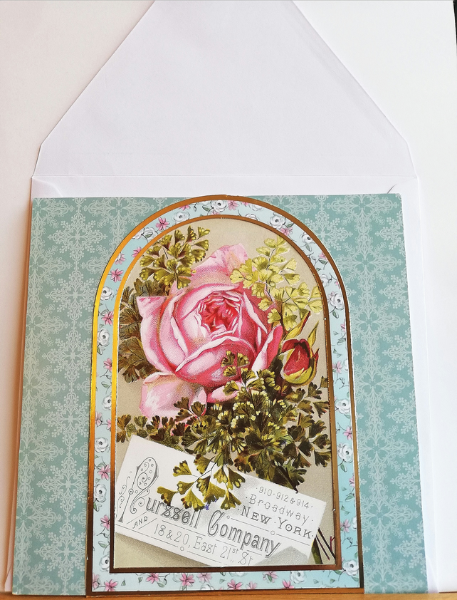 Birthday card showing rose in gold edged frame