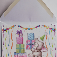 Horizontal fold card showing elephant with lots of gifts