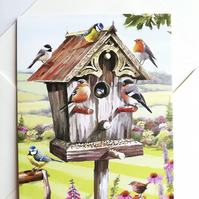 Blank card showing bird house with birds