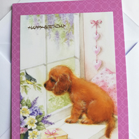 Puppy at the window birthday card