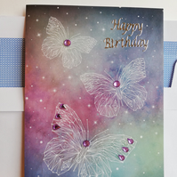 Butterflies in starfield birthday card