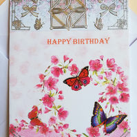 Handmade birthday card showing heart of flowers with butterflies