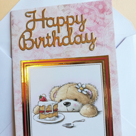 Birthday card showing cute teddy bear with a large slice of cake