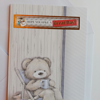 Cute Father's day card showing teddy bear on a deck chair