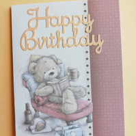 Birthday card showing cute teddy bear on a chair