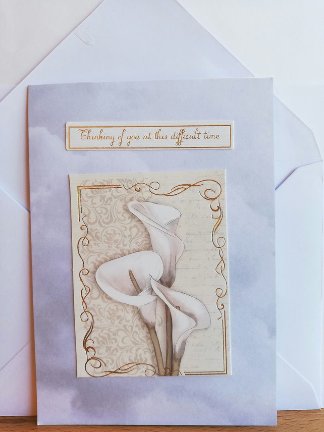 Deepest sympathy card showing lilies