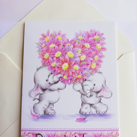 Cute elephants with heart of flowers best wishes card