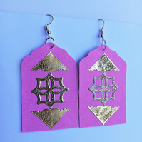 gold Celtic design on pink background earrings