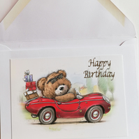 Cute teddy bear in a car birthday card