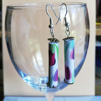 paper bead earrings showing tulips on light background