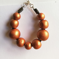 Wooden beads on leather bracelet