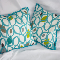 PAIR Teal leaf print cushions with bobble trim