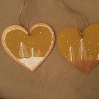 Pair of hanging Christmas snow scene wood hearts, rustic look