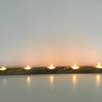 A Rustic Wooden Tealight Candle Holder for Five Tealights