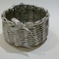 Small basket woven from newspaper tubes