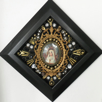 A Lozenge Shaped Frame featuring Mixed Media.