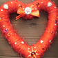 Hand made red heart shaped Christmas wreath