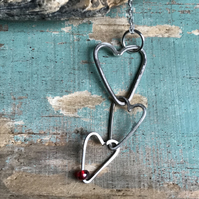 Three hanging silver hearts necklace