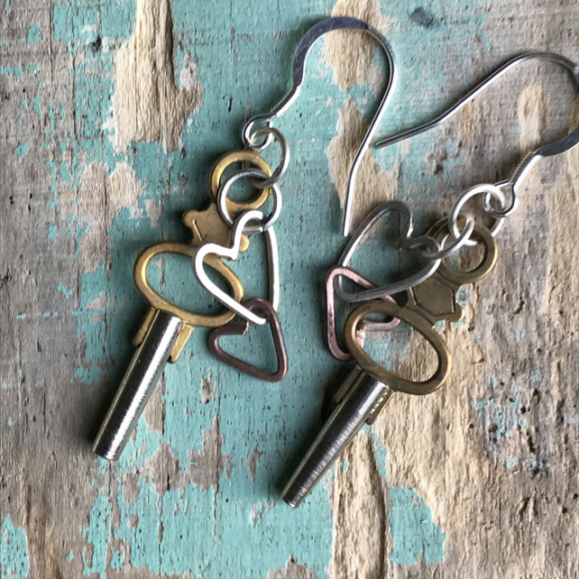 Pocket watch key and hearts earring