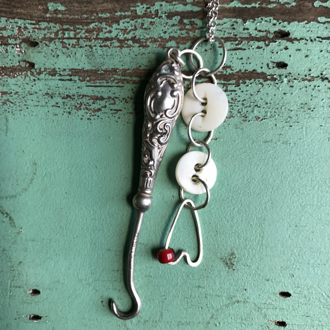 Silver button hook, button and heart necklace