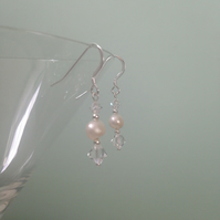 White freshwater pearl and swarovski crystal drop earrings. Sterling silver.