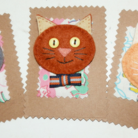 Felt cat brooches